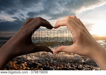 Black And White Hands In The Form Of Heart Isolated On White Background. Interracial Friendship Stop