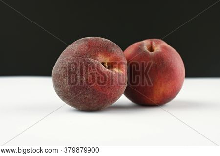 Hairy Peaches On A White And Black Background