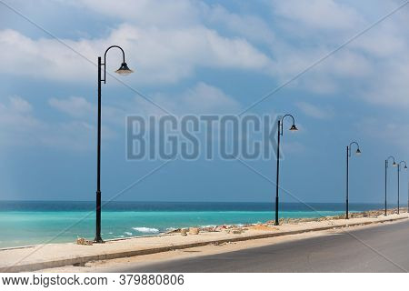 The Road Along The Turquoise Sea. Lebanese Mediterranean Coastline. Street Lights On The Waterfront