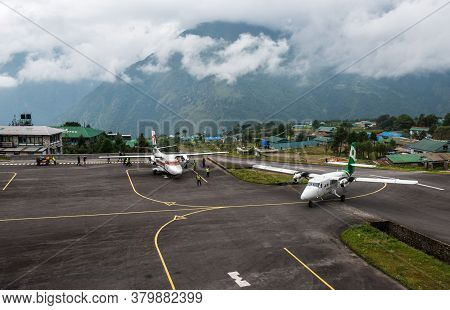 Lukla, Nepal : September-29-2018 : The Aircraft Landing On The Runway Of Tenzing-hillary Airport, Th