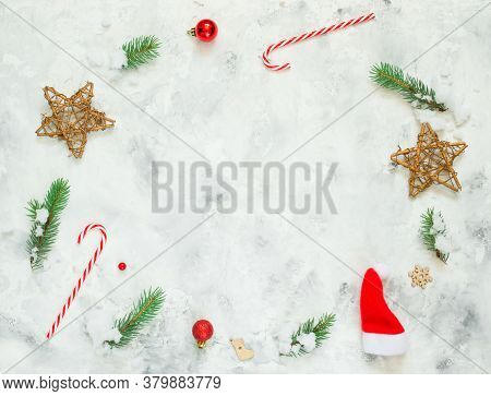 Christmas Composition. Fir Tree Branches, Snow, Red Christmas Balls On White Concrete Background. Ch