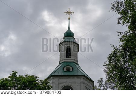 Bell Tower On Background Of Cloudy Sky. Beautiful Christian Church With Cross In Cloudy Weather.