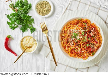 Spaghetti With Ragout With Tomatoes And Ground Italian Pork Sausages Sprinkled With Shredded Parmesa