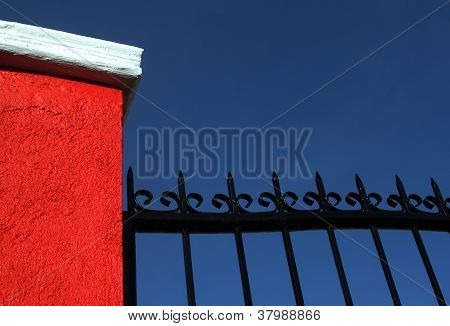 Concrete And Iron Fence