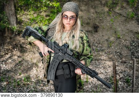 Attractive Female Soldier Hold Rifle Machine Gun. Woman With Weapon