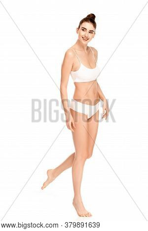Barefoot Woman With Perfect Body Looking Away And Walking Isolated On White