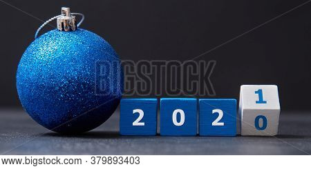 Wooden Cubes With Number, Ball With Tinsel. New Year And Xmas Celebration. Winter Holiday. Xmas Deco