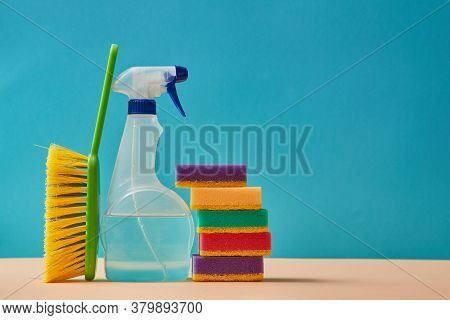 Housekeeping. Cleaning Materials. Purging. Wiper Fluid Spray. Stack Of Colourful Sponges. Brush. Cop