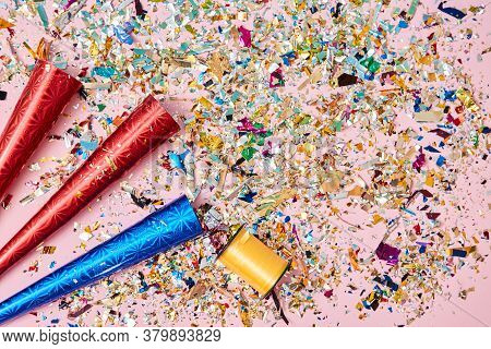 Happy Birthday. Festive Party. Event Decoration. Bright Colourful Confetti. Red And Blue Firecracker