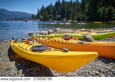 Kayaks On The Beach Deep Cove Bc. Kayaks On The Beach Of Deep Cove, British Columbia.