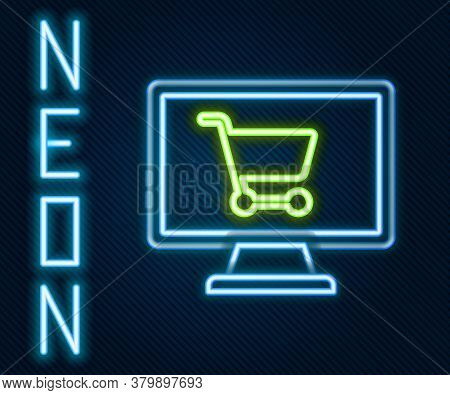 Glowing Neon Line Shopping Cart On Screen Computer Icon Isolated On Black Background. Concept E-comm