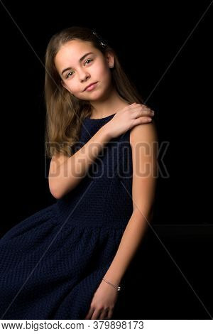 Beautiful Little Girl On A Black Background. Studio Photography.close-up.