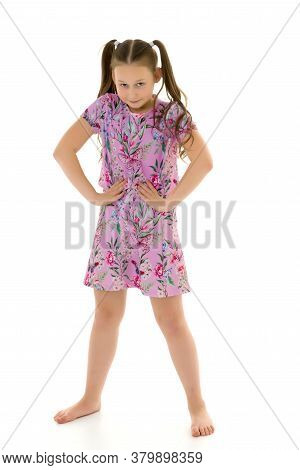 Beautiful Little Girl In An Elegant Dress In Full Growth. The Concept Of Style And Fashion. Layout F