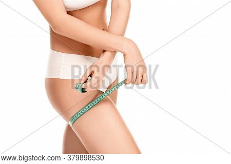 View Of Woman In Panties Measuring Thigh Isolated On White