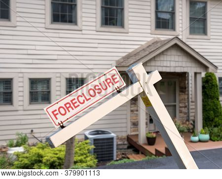 Mockup Of A Foreclosure Sign In Front Of A Modern Townhome Or Townhouse To Illustrate Recession Fear