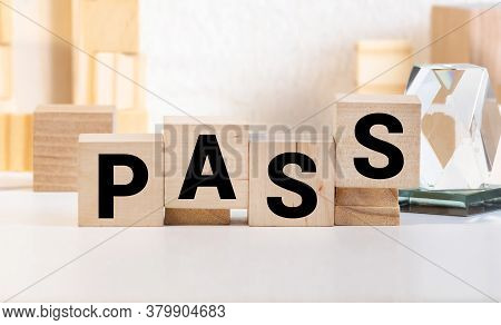 Letter Block In Word Pass On Wood Background