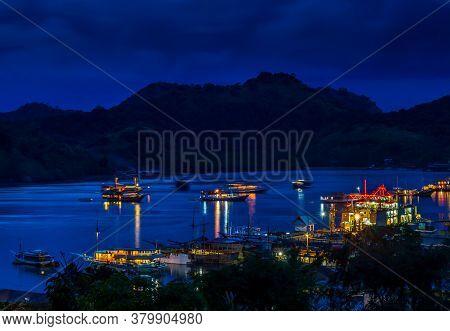 A View Over The Harbour At Labuan Bajo And Nearby Island At Night, Flores, Indonesia
