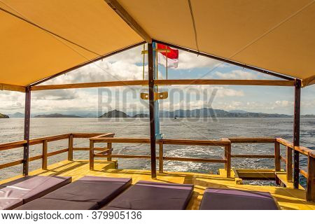 A View Of The Flores Coastline From The Upstairs Of A Liveaboard, On A Sunny Day In Indonesia
