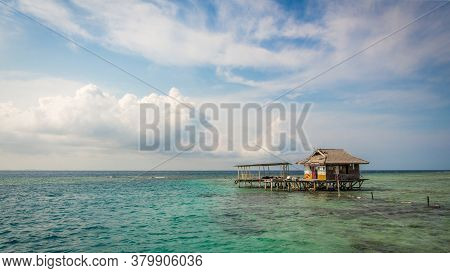 A Stilt House Over The Ocean On The Tropical Island Of Pramuka, Thousand Islands, Indonesia