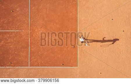 Healthy Lifectyle. A Young Girl Plays Tennis On The Court. The View From The Air On The Tennis Playe