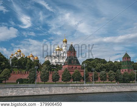 Beautiful View Of Moscow. Kremlin Embankment On A Summer Day. Towers Of The Moscow Kremlin. Bell Tow
