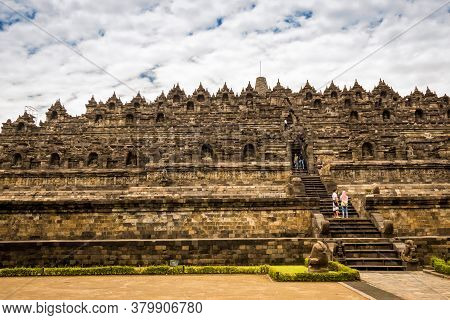 Borobudur, Indonesia - October 15th 2016: Tourists Climbing The Stairs At The Buddhist Temple Of Bor