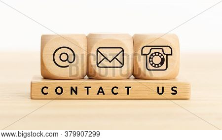 Contact Us Concept. Wooden Blocks With Email, Mail And Telephone Icons.website Page Contact Us Or E-