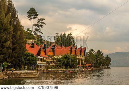 A Row Of Bataknese Houses And Villas On The Shore Of Lake Toba, North Sumatra, Indonesia