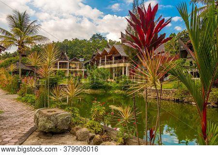 A Lake And A Bataknese Architecture On The Shore Of Lake Toba, North Sumatra, Indonesia
