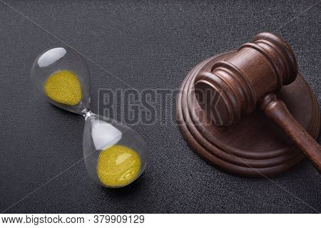 Hourglass And Judges Gavel On Black Background. Time Of Auction. Law And Time Concept.