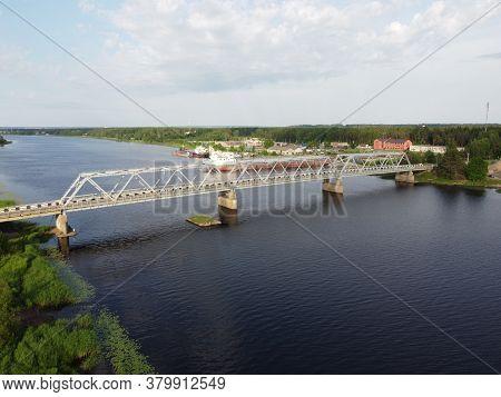 Truss Iron Bridge Through River, View An Air, Aerial Photo. High Quality Photo