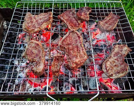 Beef Steaks Are Grilled On The Grill On The Coals On The Grill