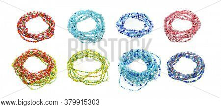 Beaded bracelets on a white background. Colored beads