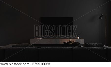 Blank Tv Screen In Modern Dark Interior With Gray Sofa In Darkness Mock Up, Front View. Tv In Living