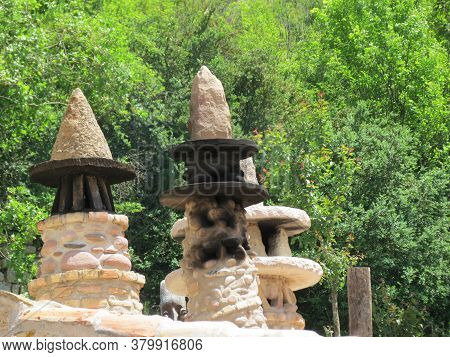 Traditional Chimneys In Pyrenees, Basque Country, Spain: Cone Shaped Beige Stone Structures With Mar