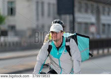London, England - May 27, 2020: Deliveroo Delivery Cyclist In Central London, England During The Cor