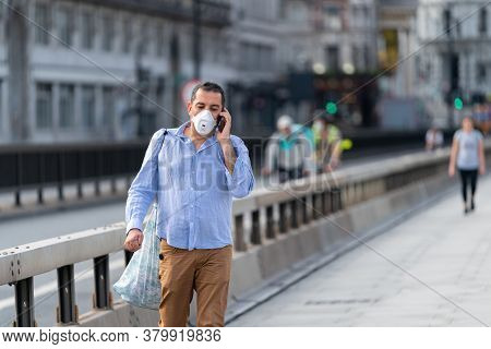London, England - May 27, 2020: Middle Aged Middle Eastern Man Walking Along Waterloo Bridge In Lond