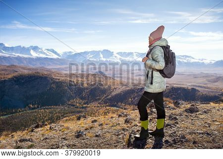Hiker Walking On A Mountain At Autumn Day. Concept Active Lifestyle With Copy Space.