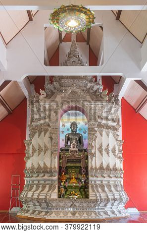 Phayao, Thailand - Dec 8, 2019: Black Buddha Statue In White Pagoda Or Stupa With Natural Light In P