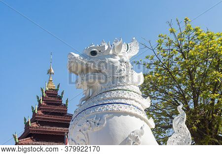 Phayao, Thailand - Dec 31, 2019: White Thai Lion On Blue Sky And Green Tree Background In Wat Nantar