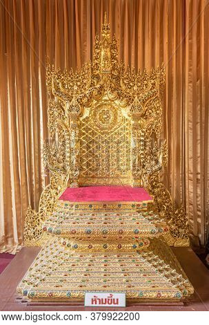 Phayao, Thailand - Dec 31, 2019: Gold Platform Seat For Monk On Curtain Background In Wat Phra Nang