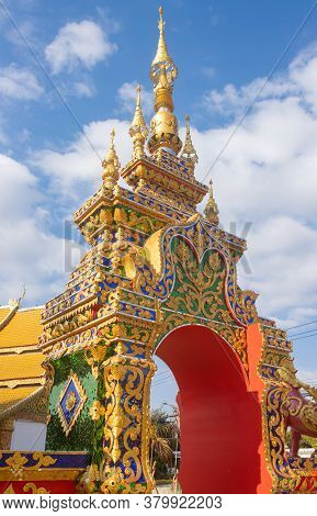 Phayao, Thailand - Dec 31, 2019: Gold Pagoda Or Stupa Entrance Door On Blue Sky Background In Portra