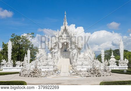Chiangrai, Thailand - June 7, 2020: Rong Khun Temple Or Wat Rong Khun On Blue Sky Background At Fron