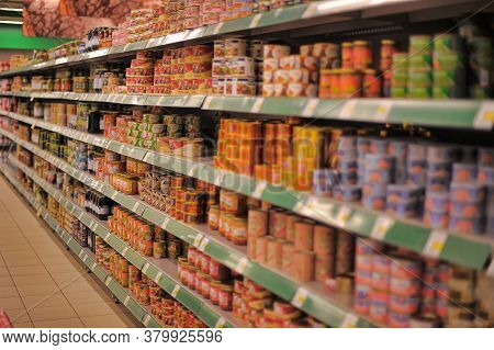 Russia, St. Petersburg 28.07,2018 Tin Cans With Canned Goods On A Supermarket Shelf