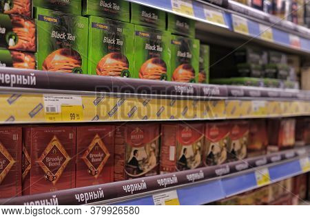 Russia, St. Petersburg, 08,03,2014 Packages With Tea And Cofen Shelves In The Supermarket