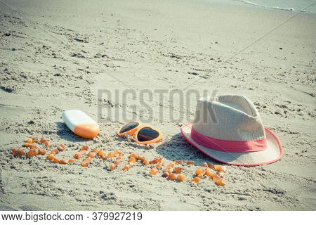 Inscription Summer Made Of Amber Stones, Sunglasses, Sun Lotion And Straw Hat. Sunbathing, Summer An