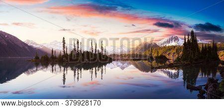 Garibaldi Lake During A Colorful Morning Sunrise. Cloudy Sky Overlay. Panoramic Canadian Mountain La