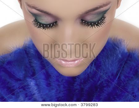 Girl with beautiful make up and rhinestones on her eye lashes poster