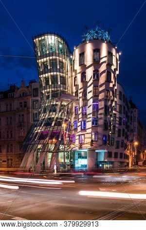 Prague, Czech Republic - July 10 2020: Dancing House Illuminated At Night. Nicknamed Fred And Ginger