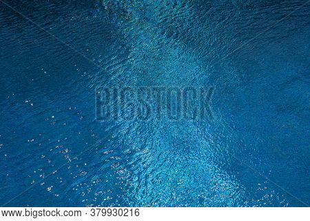 Soft Focus Background. Swimming Pool Water Texture In Abstract Style On Blue Background. Ripple Wate